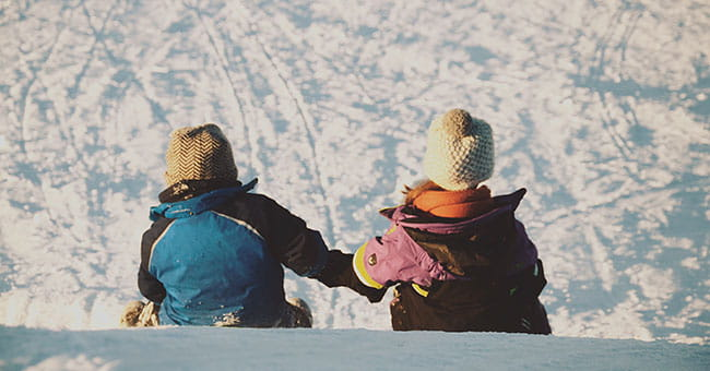 kids holding hands in snow