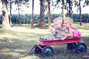 kids playing in a red wagon